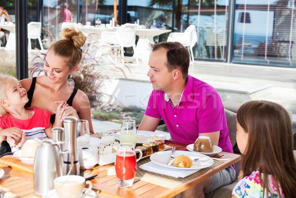 Family having brunch outside on a sunny day Stock photo © dashapetrenko