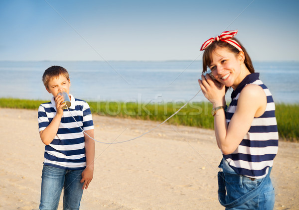 Kids having a phone call with tin cans Stock photo © dashapetrenko
