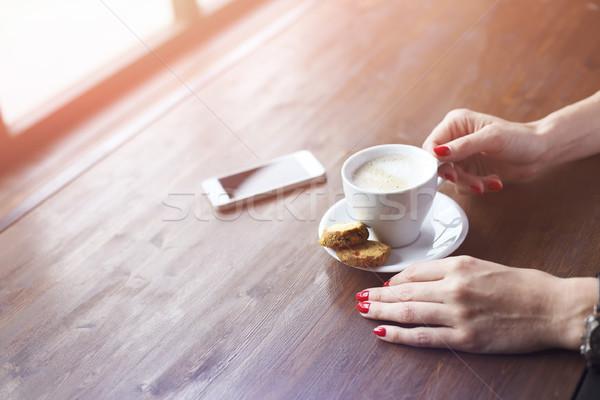 Young woman drinking coffee in cafe near window top view Stock photo © dashapetrenko