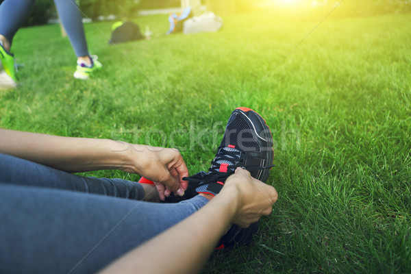 Woman lacing running shoes before workout. Close up Stock photo © dashapetrenko