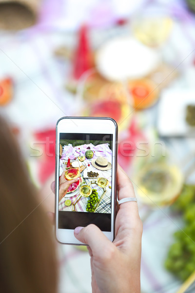 Young girl making food photo at summer picnic Stock photo © dashapetrenko