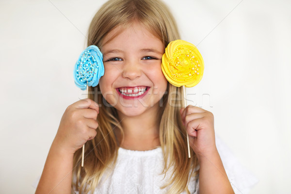 Cute little girl with candies Stock photo © dashapetrenko