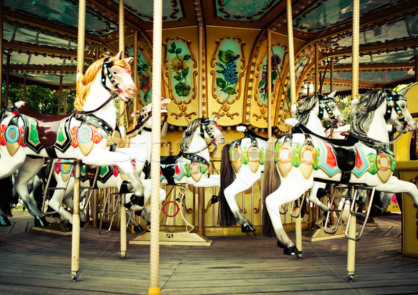 Stock photo:  Horses on a carnival Merry Go Round