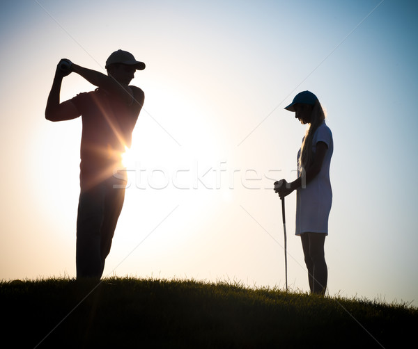 мужчины женщины играет гольф закат семьи Сток-фото © dashapetrenko