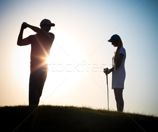 Male and female golfers playing golf  Stock photo © dashapetrenko