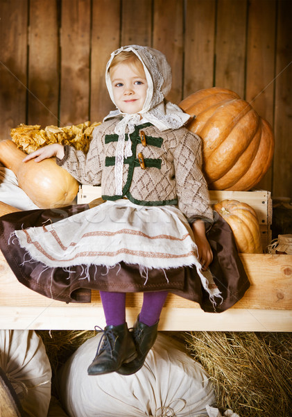 Vintage styled photo of little girl in farm Stock photo © dashapetrenko