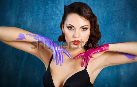 Beautiful sexy young brunette woman holding palms with sequins  Stock photo © dashapetrenko
