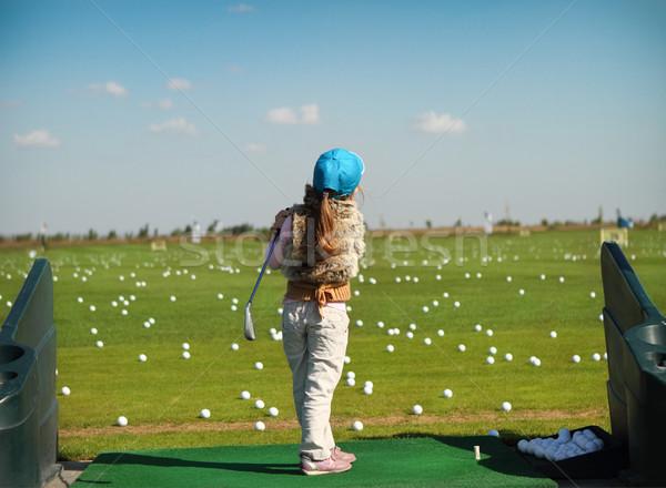 Luttle girl swinging golf club Stock photo © dashapetrenko