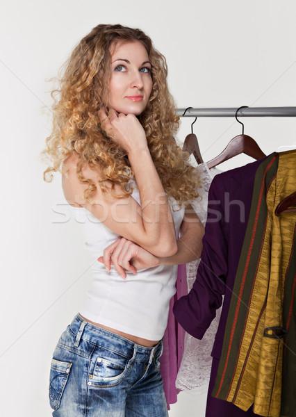 Portrait of a girl selecting clothes  Stock photo © dashapetrenko