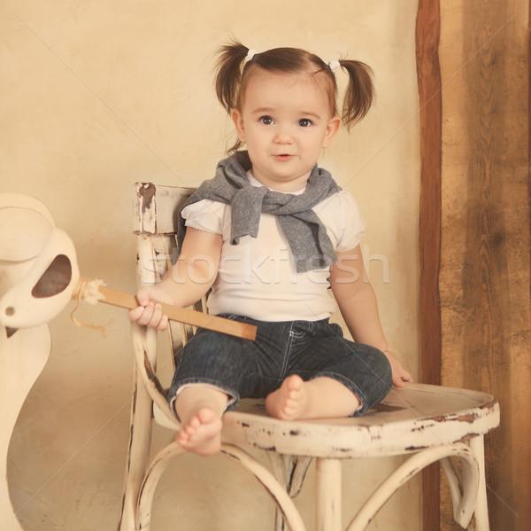 Portré mosolyog egyéves kislány bent baba Stock fotó © dashapetrenko