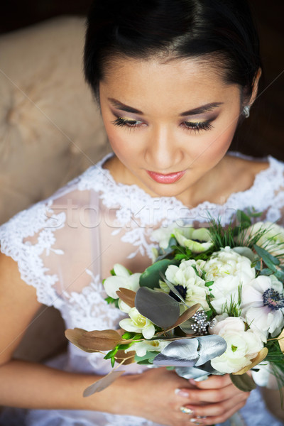 Bride holding unusual wedding bouquet with ranunculus Stock photo © dashapetrenko