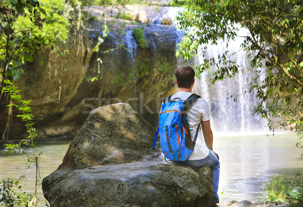 Man looking at scenic waterfall in Vietnam Stock photo © dashapetrenko