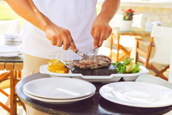 Сток-фото: человека · приготовления · стейк · горячей · каменные · Открытый