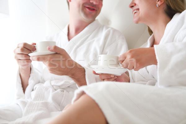 Férfi nő fürdőköpeny ágy iszik kávé Stock fotó © dashapetrenko
