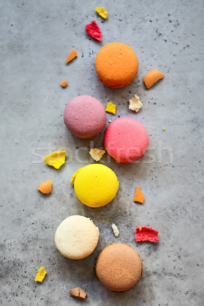 Stack of colorful French macarons on a dark rustic background Stock photo © dashapetrenko