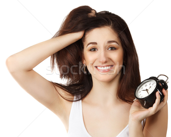 Surprised young brunette woman holding clock  Stock photo © dashapetrenko