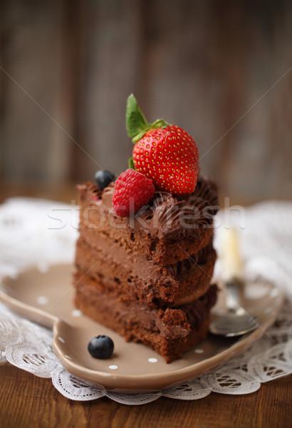 Piece of chocolate cake with icing and fresh berry  Stock photo © dashapetrenko