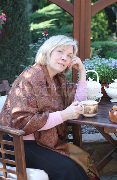 Middle age woman in the garden Stock photo © dashapetrenko