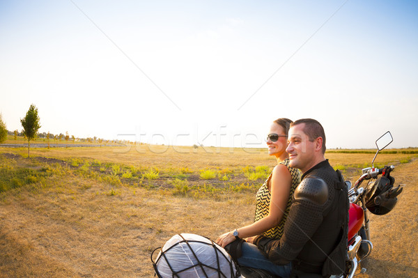 Biker couple on the country road against the sky Stock photo © dashapetrenko