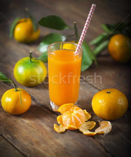 Glass of fresh tangerine juice with ripe tangerineswith old-fash Stock photo © dashapetrenko