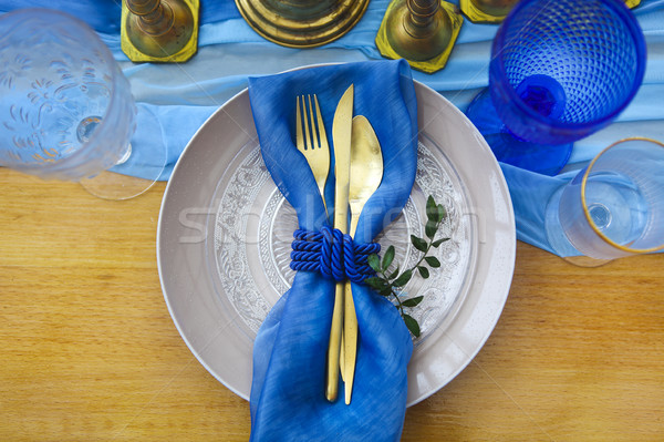 Table setting in vintage style in golden and blue colors Stock photo © dashapetrenko