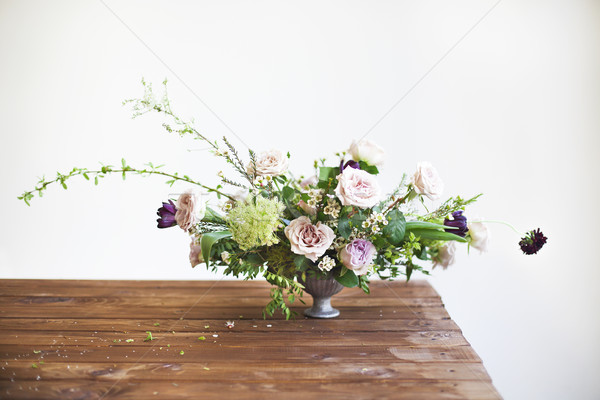 Bouquets of pink and violet flowers on a table Stock photo © dashapetrenko