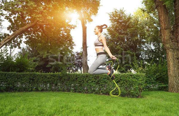 Stock fotó: Fiatal · sportos · nő · ugrik · kötél · képzés