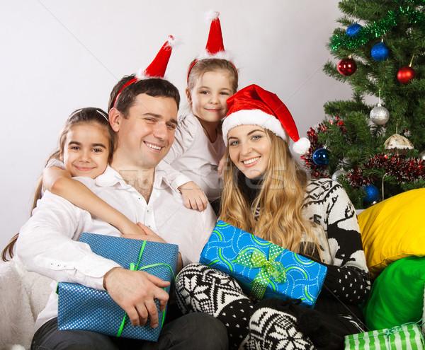 Happy family near the Christmas tree Stock photo © dashapetrenko