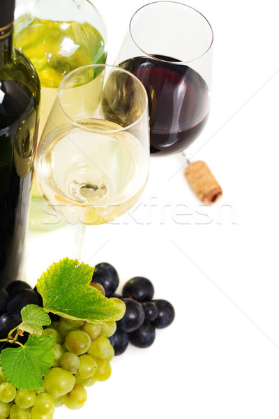 Glasses of white and rose wine and grapes over white Stock photo © dashapetrenko