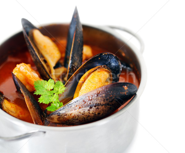 Stock photo: Copper pot of gourmet mussels