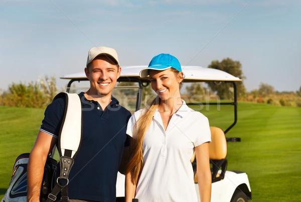Stok fotoğraf: Genç · çift · oynama · golf · golf · sahası · ayakta