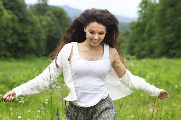 Happy pretty brunette woman in chamomile field, cute female rela Stock photo © dashapetrenko
