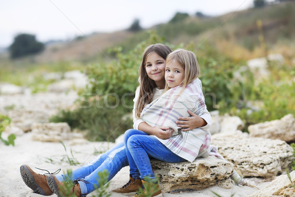 Happy sisters outdoors in plaid hugging Stock photo © dashapetrenko