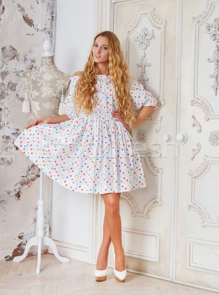 Portré gyönyörű szőke lány pöttyös ruha Stock fotó © dashapetrenko