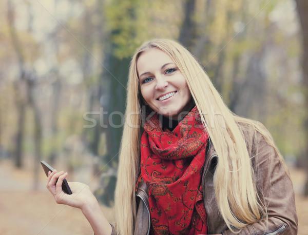 портрет улыбаясь красивая женщина sms осень Сток-фото © dashapetrenko