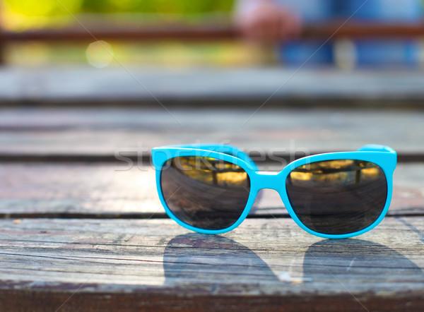 Turquesa óculos secretária mulher sol Foto stock © dashapetrenko