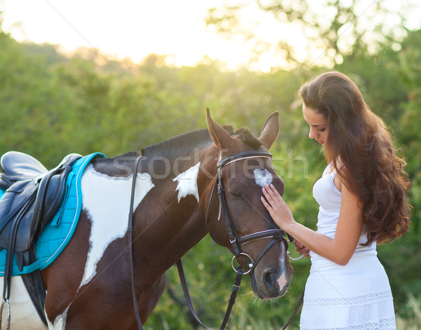 Beautiful woman and a horse Stock photo © dashapetrenko
