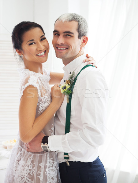 Cheerful married couple in white room Stock photo © dashapetrenko