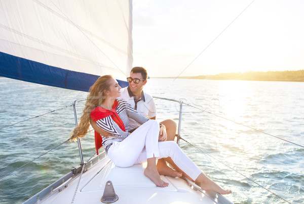 Stock photo: Young smiling couple on a sailing boat at summer