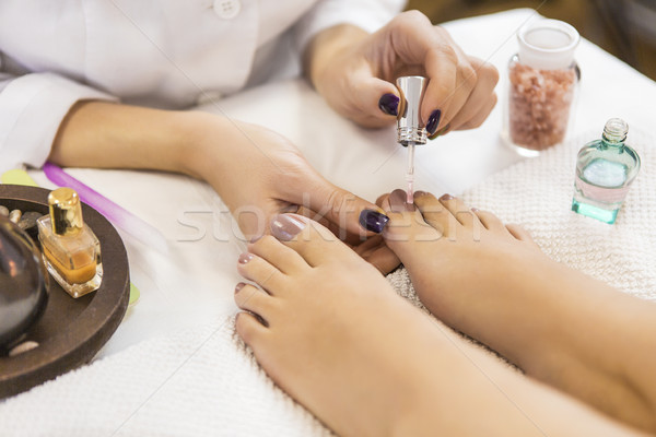 Pedicure at beauty salon. Nail polishing. Close up. Stock photo © dashapetrenko