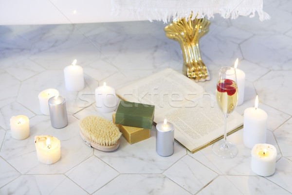 Close up of candles, book, glass of champagne by the bath  Stock photo © dashapetrenko