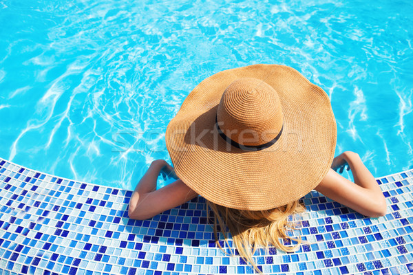 Woman in a hat enjoying a swimming pool Stock photo © dashapetrenko