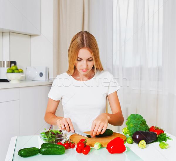 Young woman cutting vegetables  Stock photo © dashapetrenko