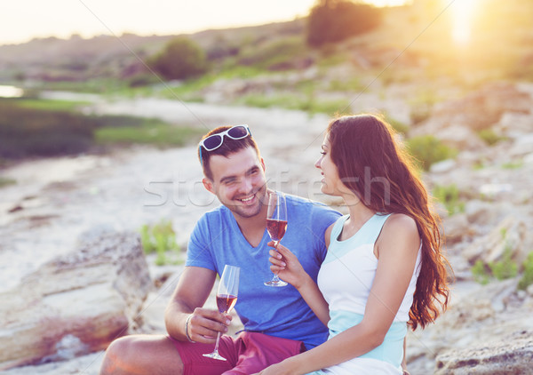 Happy couple toasting champagne sparkling wine at a relax party Stock photo © dashapetrenko