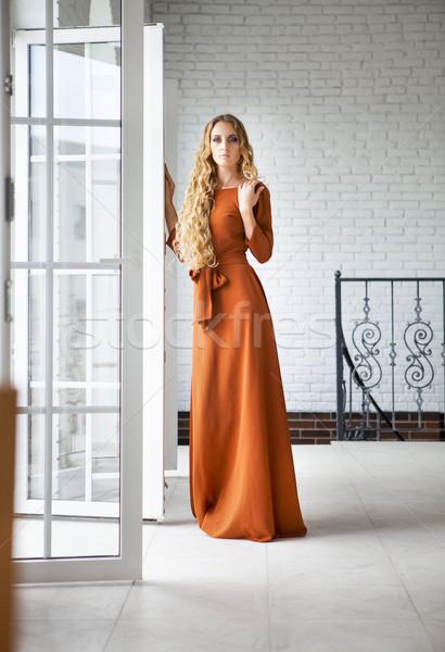 Szőke nő hosszú ruha lépcsősor gyönyörű Stock fotó © dashapetrenko