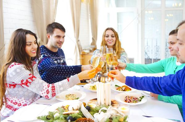 Amis champagne Noël dîner groupe Photo stock © dashapetrenko
