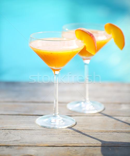 Champagne glasses with peach Bellini cocktail Stock photo © dashapetrenko