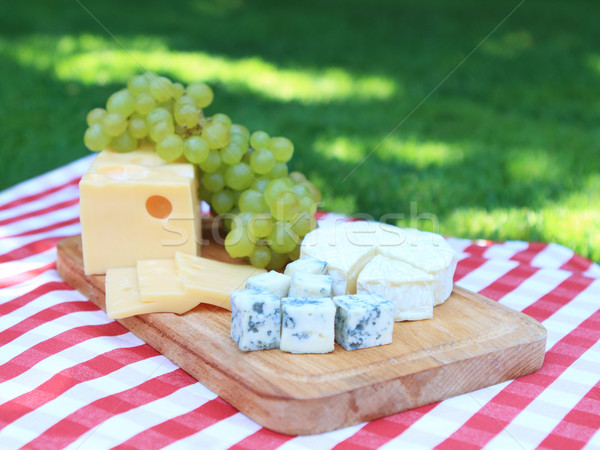 Cheese with  white grapes Stock photo © dashapetrenko