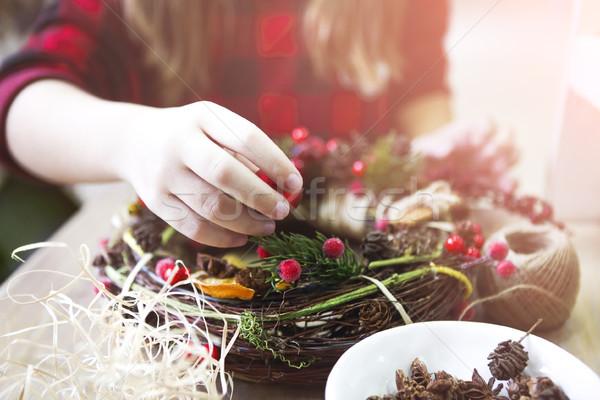 Christmas wreath in young womans hands Stock photo © dashapetrenko