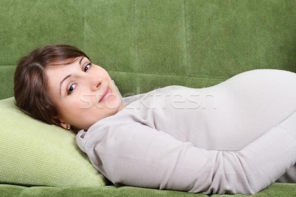 Young pregnant woman relaxing on sofa Stock photo © dashapetrenko